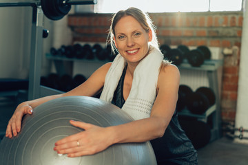 Smiling slender young woman working out