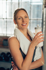 Cheerful healthy young woman in a gym