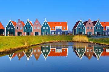 Colored houses of marine  park in Volendam reflected in the water, Netherlands Wall mural