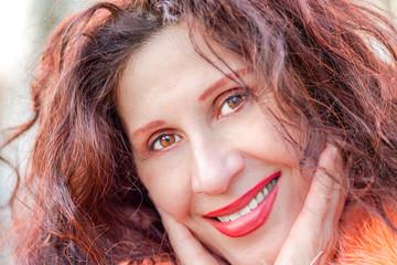 Closeup of a beautiful smiling mature woman
