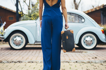 beautiful woman with suitcase and car