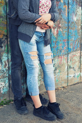 Young couple hugging in urban environment