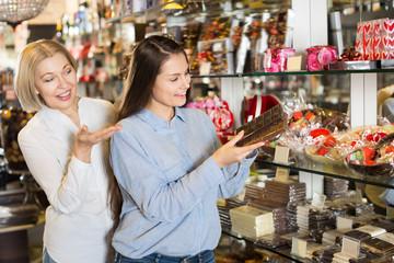 Female customers selecting chocolate