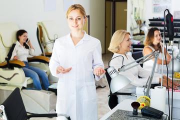 Woman manicurist in nail salon