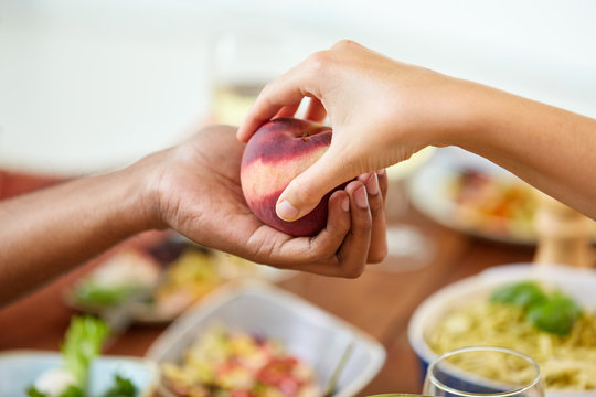multiracial couple hands with peach