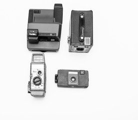 Four old out of date cameras arranged in flat design on white