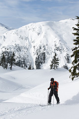 Young man ski touring in the mountains