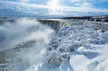 Visitors take pictures of ice covered Niagara Falls in Niagara