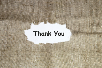 thank you word under torn paper