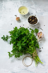 Fresh parsley on a light stone or slate background. Flat lay. Top view with copy space.
