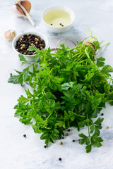 Fresh parsley on a light stone or slate background.