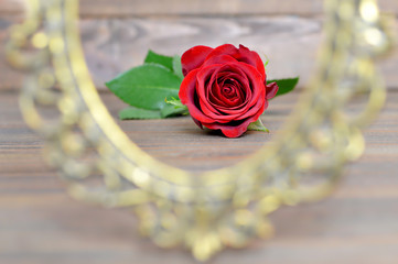 Valentines Day rose and vintage frame