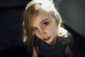 High angle portrait of girl at home
