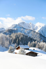 Fototapete - Amazing winter scenery. Alpine hut covered with a snow