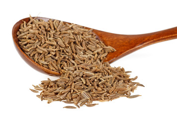 Dried cumin seeds in wooden spoon isolated on white background
