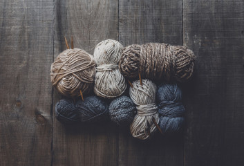 Overhead view of woolen balls on table