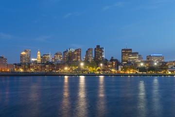 Boston City Skyscrapers, Custom House and Boston Waterfront at night from East Boston, Boston, Massachusetts, USA.