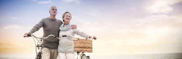 Happy senior couple with their bike