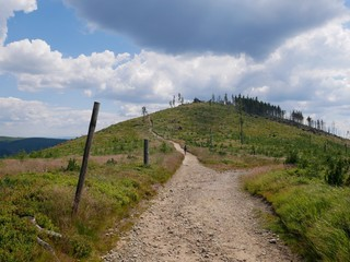 Stony trail leading through mountains in the summer
