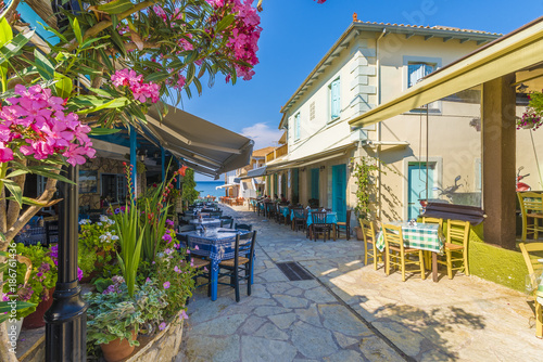 Wall mural Traditional restaurant and taverna in Agios Nikitas village, Lefkada, Greece