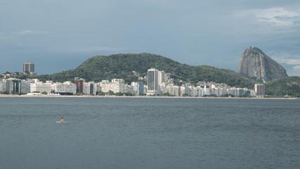 Lonely woman adrift overlooking Copacabana Beach, Rio de Janeiro