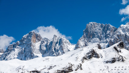 Extreme winter landscape of Dolomites seen from Passo Rolle, Italy