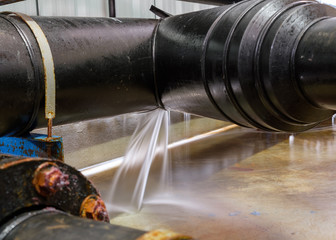 Pipe leakage due to water pressure.