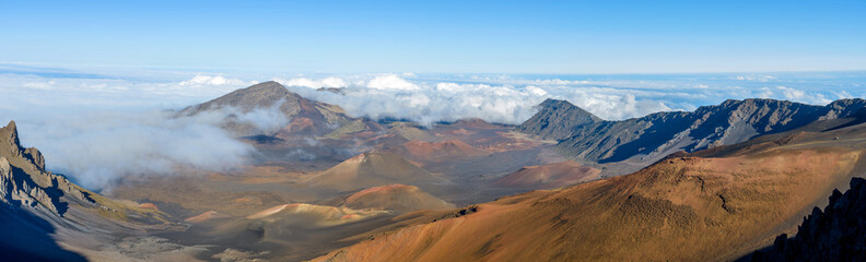 Haleakala Crater - A panoramic view of the crater at summit (10,023 feet) of Haleakala, also called East Maui Volcano, surrounded by sea of clouds. Maui, Hawaii, USA.
