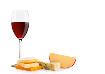 Glass of red wine with cheese selection and grapes