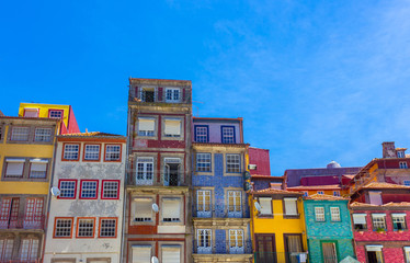 Colorful Houses at Ribeira District, Porto , Portugal. Multicolor Design concept. Architecture with colorful facade.
