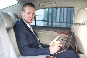 Business man using Laptop for working in car with attractive smiling, Man working concept.