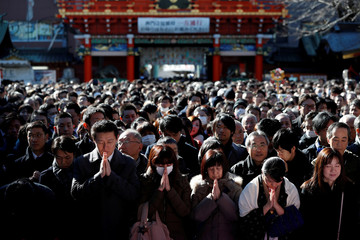People offer prayers on the first business day of the year at the Kanda Myojin shrine in Tokyo