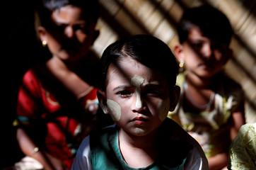 Rohingya refugee children sit inside a classroom at Kutupalong refugee camp, near Cox's Bazar