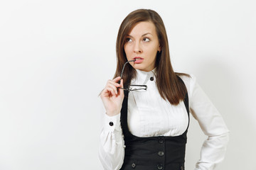 Beautiful sexy caucasian young smiling brown-hair business woman in black suit, white shirt and glasses looking aside isolated on white background. Manager or worker. Copy space for advertisement.