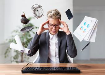 Fototapeta Businesswoman working on a laptop, overworking, under pressure   obraz
