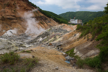 Smoke vents escaping from the earth's surface in Hell Valley (Jigokudani), Noboribetsu, Hokkaido, Japan