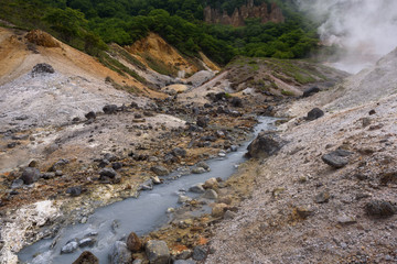 Small river streams through the rocks of Hell Valley (Jigokudani), Noboribetsu, Hokkaido, Japan
