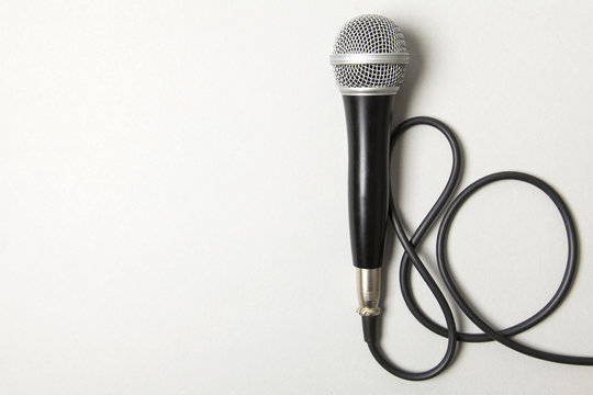 microphone and lead on a plain grey background.