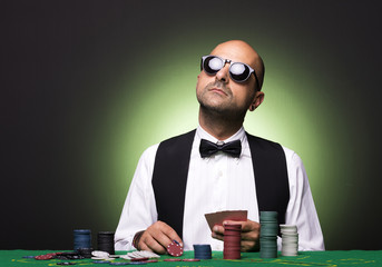 Pensive Poker player at the table