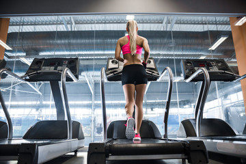 Woman on treadmill in the gym