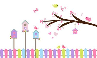 Rama de árbol, nidos y valla de colores.