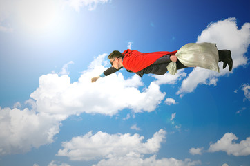 Flying super hero man with a bag in the sky isolated on white background. Superhero pollution concept.