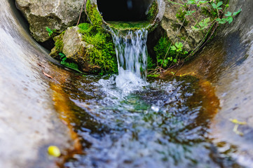 flowing water spring pipe