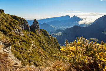 Piton Maido, La Reunion Island, France - August 15, 2017: Tourists on the Maido lookout overlooking Cirque of Mafate, listed as World Heritage by UNESCO, La Reunion Island, France.