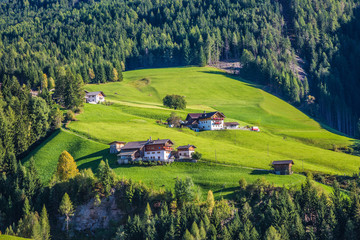 Chalet on a green grassy slope