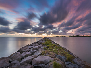 long exposure used to stretch the clouds and calm the water Wall mural