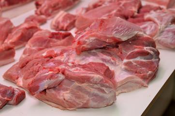 Fresh pork is sold in the market