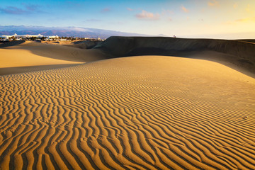 Lonely photographer on dunes in Maspalomas the Gran Canaria island.