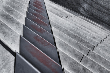 Architectural stairs of cement and steel at diagonal lines