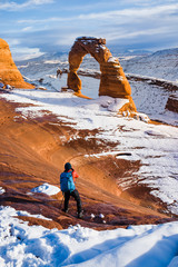 The Photographer taking pictures at Delicate Arch with Snow in Winter